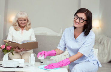 caregiver cleaning the table