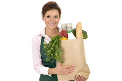 woman holding vegetables she bought from the grocery